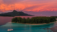 Dramatic Tahiti sunset with Catamaran