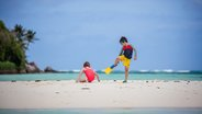 Kids playing on Seychelles beach