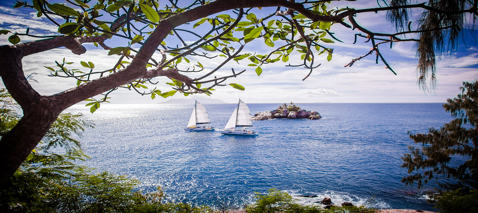 Two catamarans sailing in the Seychelles